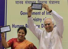 HRD Minister Kapil Sibal with MoS HRD D. Purandeswari