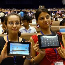 Students show their Aakash tablet