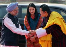 Bhutan King Jigme Khesar Namgyel Wangchuck and his wife Jetsun Pema with PM Manmohan Singh.