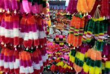 Man sells artificial garlands for Diwali
