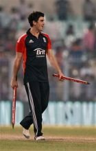 Craig Kieswetter carries the stumps to celebrate