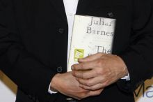 Julian Barnes holding a copy of his novella The Sense of an Ending