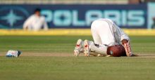 Shivnarine Chanderpaul kisses the ground after scoring a century