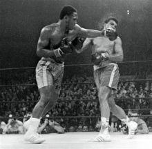 Joe Frazier in a match against Muhammad Ali