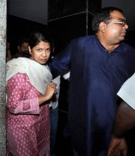 DMK MP Kanimozhi with her husband Arvindan at her residence.