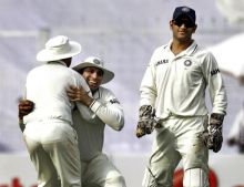 V.V.S. Laxman (centre), Virender Sehwag (left) and captain MS Dhoni