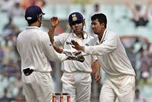 Pragyan Ojha (right) with team-mates Gautam Gambhir (centre) and captain Mahendra Singh Dhoni