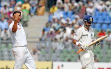 Ravi Rampaul (right) celebrates the wicket of India's Gautam Gambhir