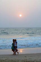 Tourist walk at a Goa beach