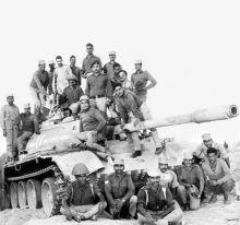 Indian soldiers atop a captured Pakistani tank at Bhachbar, Rajasthan, 1971