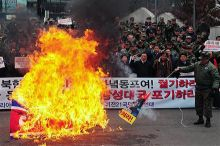 South Korean war veteran burns a North Korean flag