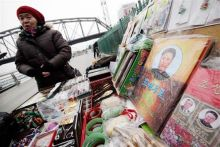 Vendor sells books on late North Korean leader Kim Jong-Il