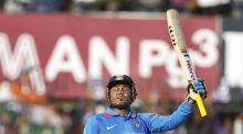 Virender Sehwag raises his bat post his 200