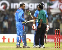 Virender Sehwag is congratulated by a groundsman