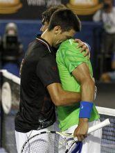 Novak Djokovic hugs Rafael Nadal