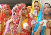 Women queue up outside a polling booth in Mumbai