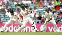 Michael Clarke, MS Dhoni (left) and Rahul Dravid (right)