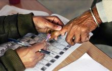 Voter's finger being inked at a polling booth