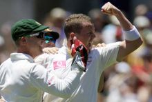 Peter Siddle (right)