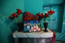A portrait of Jayaramappa (who committed suicide) with his wife and daughter