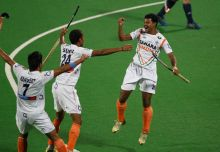 Birendra Lakra with teammates Sunil Vitalacharya Sowmarpet and Manpreet Singh