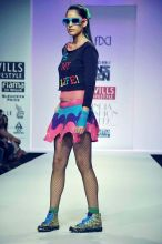 A model displays a creation by designer Niharika