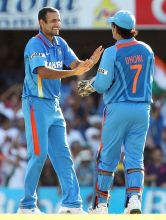 Irfan Pathan (left) and MS Dhoni