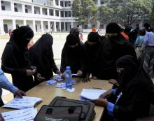 Women voters collect their voting slips