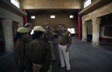 A police officer instructs his officers at a polling station in Ayodhya