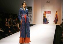 A model walks the ramp on Day 4 of WIFW