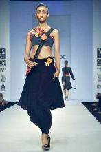 A model flaunts a creation by designer Ritu Pande