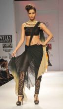 A model flaunts a creation by designer Sulakshana