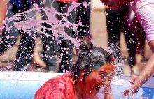 Children play with water and colours during Holi