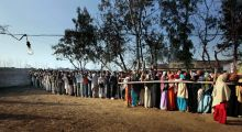 Voters stand in a queue