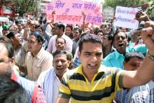 Protest against IPS officer's killing