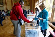 A French voter casts his vote