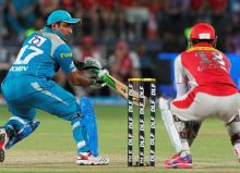 Robin Uthappa (left) plays shot against Kings XI Punjab