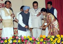 Prime Minister Manmohan Singh lights the lamp
