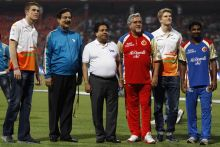 Subroto Roy, second left, Vijay Mallya, third right, stand with IPL Chairman Rajiv Shukla, third left, cricketer Muttaiah Muralitharan, right, and Sahara Force India drivers Paul di Resta, left, and Nico Hulkenberg