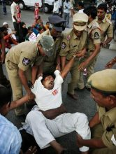 Police detain protester during Bandh