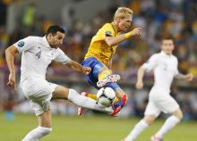 France's Adil Rami, Sweden's Christian Wilhelmsson