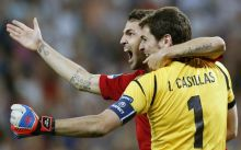 Spain's Cesc Fabregas celebrates with his team-mate Iker Casillas