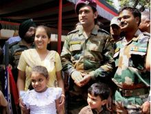 Mahendra Singh Dhoni with soldier and his family