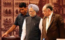 Manmohan Singh with S.H. Kapadia