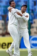 Pragyan Ojha (left) and team-mate Suresh Raina