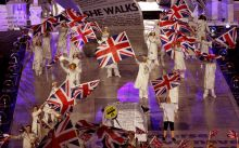 Performers wave the British flag