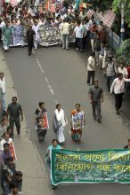 Mamata Banerjee (centre) with Trinamool Congress workers at protest rally in Kolkata