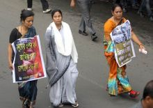 Mamata Banerjee (centre) with Trinamool Congress workers at a protest rally in Kolkata
