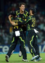Pat Cummins (center) celebrates taking wicket of Virat Kohli