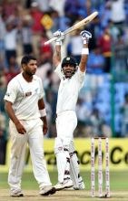 Virat Kohli (right) celebrates their win over New Zealand
